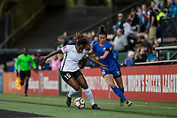 Seattle, WA - April 15th, 2017: Kayla Mills and Carson Pickett during a regular season National Women's Soccer League (NWSL) match between the Seattle Reign FC and Sky Blue FC at Memorial Stadium.