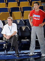"22 November 2008:  New Orleans Volleyball Head Coach Jozsef Forman and Assistant Coach ""James"" Tieming Li watch their players during pre-game warm-ups prior to the WKU 3-0 victory over New Orleans in the championship game of the Sun Belt Conference tournament at U.S. Century Bank Arena in Miami, Florida."