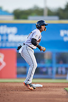 Jupiter Hammerheads third baseman J.C. Millan (24) leads off second base during a game against the Dunedin Blue Jays on August 14, 2018 at Dunedin Stadium in Dunedin, Florida.  Jupiter defeated Dunedin 5-4 in 10 innings.  (Mike Janes/Four Seam Images)