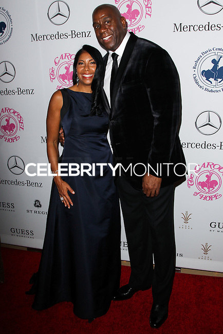 BEVERLY HILLS, CA, USA - OCTOBER 11: Cookie Johnson, Magic Johnson arrive at the 2014 Carousel Of Hope Ball held at the Beverly Hilton Hotel on October 11, 2014 in Beverly Hills, California, United States. (Photo by Celebrity Monitor)