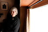 USA; New Mexico; Taos; The Mabel Dodge Luhan House, docent Judy Jordan sits by the fireplace