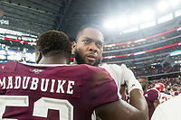 Hawgs Illustrated/Ben Goff<br /> Brian Wallace, Arkansas offensive lineman, greets Justin Madubuike, Texas A&M defensive lineman, after the game Saturday, Sept. 29, 2018, during the Southwest Classic at AT&T Stadium in Arlington, Texas.