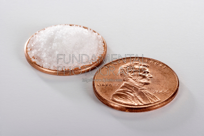 1/16 TEASPOON OR 0.3g OF SALT COMPARED TO A PENNY<br />