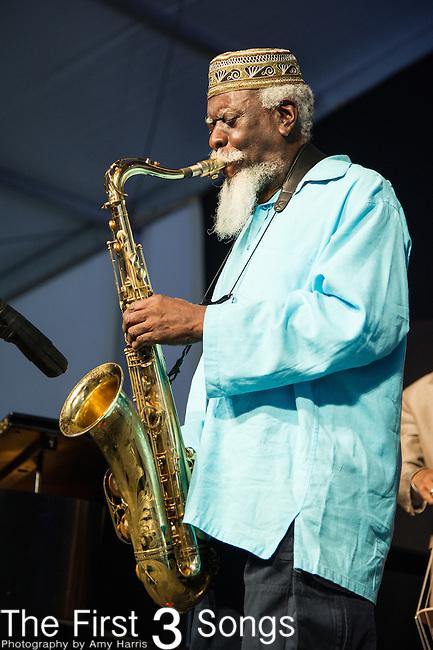 Pharoah Sanders performs during the New Orleans Jazz & Heritage Festival in New Orleans, LA.