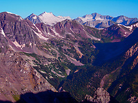 The Elk Range in Colorado contains some of Colorado's most beautiful and difficult to climb 14,000 foot peaks, including the famous Maroon Bells. The shot was taken from the summit of 14,018 foot high Pyramid Peak. The Maroon Bells are just out of sight to the left. However, the aptly named  14,092 foot high  Snowmass Mountain rises on the left with 14,130 foot high Capitol Peak on the right.