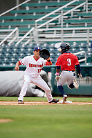 Harrisburg Senators first baseman Drew Ward (17) stretches to receive a throw as Jonathan Davis (3) crosses the bag during the first game of a doubleheader against the New Hampshire Fisher Cats on May 13, 2018 at FNB Field in Harrisburg, Pennsylvania.  New Hampshire defeated Harrisburg 6-1.  (Mike Janes/Four Seam Images)