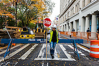 New York, NY 5 November 2015 - One day after the Department of Design announced a 200 year old burial vault, containing 12 skeletons, had been found under Washington Square East, workers preserve the site. The City plans to bring in archaeologists and the Landmarks Commission before resuming work replacing sewers along this side of Washington Square. ©Stacy Walsh Rosenstock