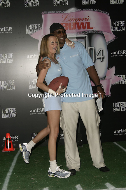 Maile Moore &amp; Eric Dickerson<br />Lingerie Bowl Kicks Off With a Star Studded Practice <br />Jackie Robinson Stadium<br />Los Angeles, CA, USA<br />December 2, 2003 <br />Photo By Celebrityvibe.com /Photovibe.com