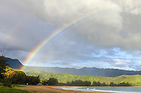 A rainbow brightens an overcast morning at Hanalei Beach and Hanalei Bay, Kaua'i.