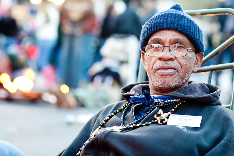 Flambeau carrier Barry Theophile takes a break at the Endymion parade on February 13, 2010 in New Orleans.