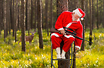 Santa (Bill Wilhelm) takes a nap in a deer stand in the woods at Shell Point Beach in Wakulla County in the Florida panhandle.