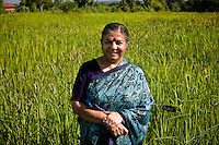 Dr. Vandana Shiva poses with her 'millet and 560 strains of rice' in Navdanya in Dehradun, Uttarakhand, India, on 6th September 2009...Dr. Vandana Shiva, the founder of Navdanya Foundation and Bijavidyapeeth, is a physicist turned environmentalist who campaigns against genetically modified food and teaches farmers to rely on indigenous farming methods.. .Photo by Suzanne Lee / For The National