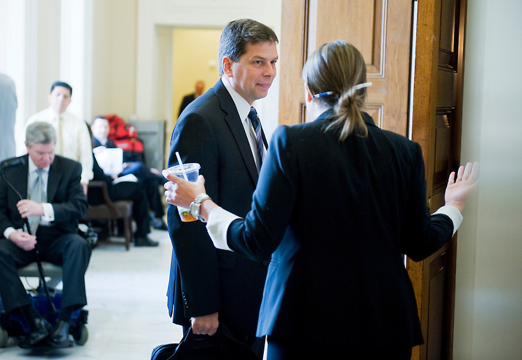 UNITED STATES - JULY 19:  Sen. Mark Begich, D-Alaska, speaks with aide Rachel Barinbaum before the democratic senate policy luncheon in the Capitol.  (Photo By Tom Williams/Roll Call)