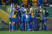 Carlos Djalo Oso of Romford scores the first goal for his team and celebrates with his team mates during Romford vs Norwich United, Bostik League Division 1 North Football at Ship Lane on 11th April 2018