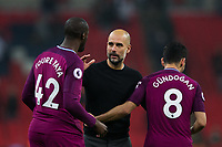 Manchester City manager Josep Guardiola celebrates with Manchester City's Yaya Toure <br /> <br /> Photographer Craig Mercer/CameraSport<br /> <br /> The Premier League - Tottenham Hotspur v Manchester City - Saturday 14th April 2018 - Wembley Stadium - London<br /> <br /> World Copyright &copy; 2018 CameraSport. All rights reserved. 43 Linden Ave. Countesthorpe. Leicester. England. LE8 5PG - Tel: +44 (0) 116 277 4147 - admin@camerasport.com - www.camerasport.com