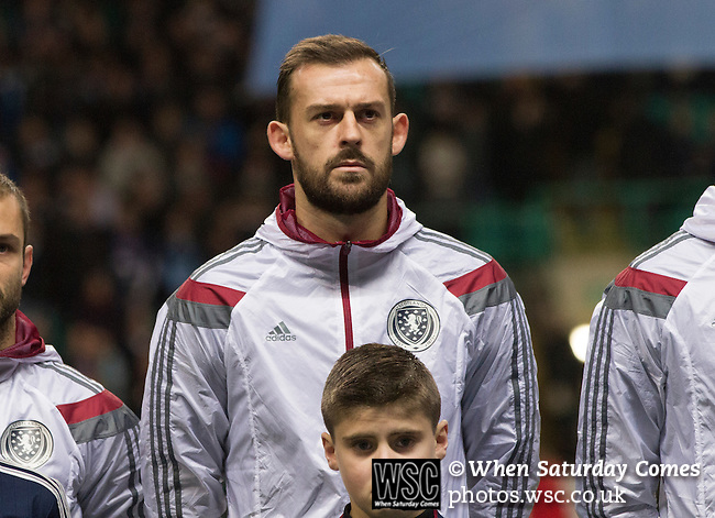 Scotland 1 Republic of Ireland 0, 14/11/2014. Celtic Park, European Championship qualifying. Home striker Steven Fletcher pictured during the playing of national anthems before the European Championship qualifying match between Scotland and the Republic of Ireland at Celtic Park, Glasgow. Scotland won the match by one goal to nil, scored by Shaun Maloney 16 minutes from time. The match was watched by 55,000 at Celtic Park, the venue chosen to host the match due to Hampden Park's unavailability following the 2014 Commonwealth Games. Photo by Colin McPherson.