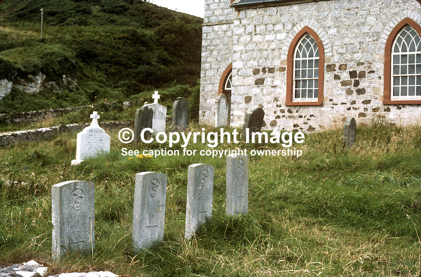 Church of Ireland, Rathlin Island, Co Antrim, N Ireland, UK. The adjoining graveyard is the last resting place of both Roman Catholics and Church of Ireland islanders. It is also the last resting place for seamen, some unidentified, whose bodies were washed ashore over the years. 197809000241j..Copyright Image from Victor Patterson, 54 Dorchester Park, Belfast, United Kingdom, UK...For my Terms and Conditions of Use go to http://www.victorpatterson.com/Victor_Patterson/Terms_%26_Conditions.html