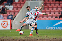 James Berrett of Grimsby scores his side's first goal under pressure from Carl Winchester of Cheltenham Town during the Sky Bet League 2 match between Cheltenham Town and Grimsby Town at the The LCI Rail Stadium,  Cheltenham, England on 17 April 2017. Photo by PRiME Media Images / Mark Hawkins.