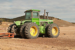 1980s John Deere 8640 tractor with plow in a cultivated field, Monterey Co., Calif.