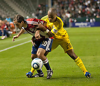 CARSON, CA – APRIL 9, 2011: Chivas USA midfielder Nick LaBrocca (10) and Columbus Crew defender Julius James (26) battle for the ball during the match between Chivas USA and Columbus Crew at the Home Depot Center, April 9, 2011 in Carson, California. Final score Chivas USA 0, Columbus Crew 0.