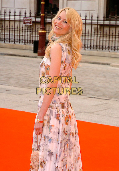 CLAUDIA SCHIFFER.The 2006 Summer Exhibition Preview Party at the Royal Academy in Piccadilly, London, UK..June 7th, 2006 .Ref: CAV.half length floral print dress white looking over shoulder.www.capitalpictures.com.sales@capitalpictures.com.© Capital Pictures.