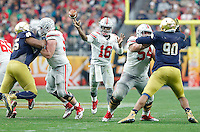 Ohio State Buckeyes quarterback J.T. Barrett (16) gets a pass off in the second half against Notre Dame in the Fiesta Bowl played at University of Phoenix Stadium in Glendale, AZ on January 1, 2016.  (Chris Russell/Dispatch Photo)