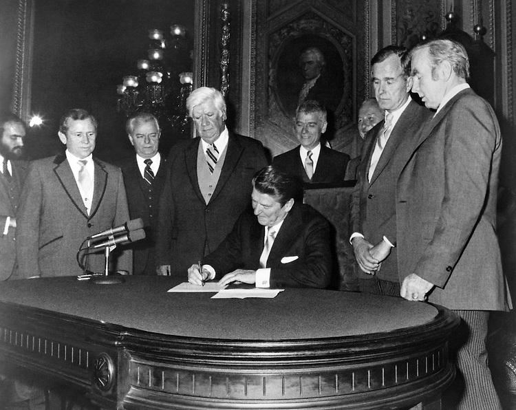 President Ronald Wilson Reagan R-Calif., signing appointments to make them official. 1985 (Photo by CQ Roll Call)