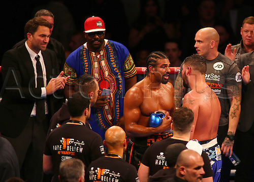 March 4th 2017, O2 Arena, London England; Heavyweight Boxing David Haye versus Tony Bellew; David Haye and Tony Bellew embrace after the The Heavyweight contest, as promoter Eddie Hearn and Dereck Chisora look on