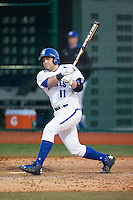 Sal Annunziata (11) of the Seton Hall Pirates follows through on his swing against the Cornell Big Red at The Ripken Experience on February 27, 2015 in Myrtle Beach, South Carolina.  The Pirates defeated the Big Red 3-0.  (Brian Westerholt/Four Seam Images)