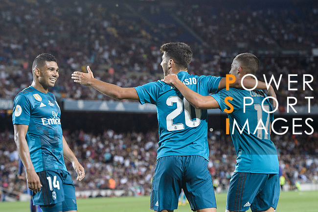 Marco Asensio Willemsen of Real Madrid (C) celebrating his score with Lucas Vazquez (R) and Carlos Casemiro of Real Madrid (L) during the Supercopa de Espana Final 1st Leg match between FC Barcelona and Real Madrid at Camp Nou on August 13, 2017 in Barcelona, Spain. Photo by Marcio Rodrigo Machado / Power Sport Images