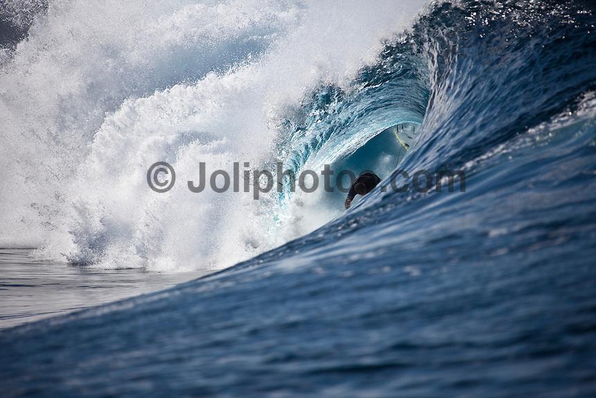 CJ HOBGOOD (USA)  surfing at a reef pass near Teahupoo, Tahiti, (Friday May 15 2009.) Photo: joliphotos.com