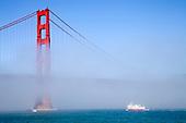 Golden Gate Bridge and ferry in fog, San Francisco, California, USA