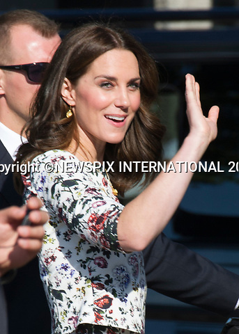 18.07.2017; Gdansk, Poland: DUKE AND DUCHESS OF CAMBRIDGE<br />visit the European Solidarity Movement at its birthplace, where they were gretted by Lech Walesa.<br />At the end of the visit they placed a rose each at the foot of the Solidarity Monument.<br />The royals will tour both Poland and Germany over the next five days.<br />Picture shows: Duke and Duchess of Cambridge with Lech Walesa, with the famous Soldarity sign inj the background.<br />Mandatory Photo Credit: &copy;Francis Dias/NEWSPIX INTERNATIONAL<br /><br />IMMEDIATE CONFIRMATION OF USAGE REQUIRED:<br />Newspix International, 31 Chinnery Hill, Bishop's Stortford, ENGLAND CM23 3PS<br />Tel:+441279 324672  ; Fax: +441279656877<br />Mobile:  07775681153<br />e-mail: info@newspixinternational.co.uk<br />Usage Implies Acceptance of OUr Terms &amp; Conditions<br />Please refer to usage terms. All Fees Payable To Newspix International
