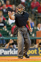 Home plate umpire Michael Bank makes a strike call during the game between the Arkansas Razorbacks and the Houston Cougars at Minute Maid Park on March 3, 2012 in Houston, Texas.  The Cougars defeated the Razorbacks 4-1.  (Brian Westerholt/Four Seam Images)