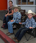 Simone, 8-year-old Reagan and 4-year-old Clayton watch the Reno Rodeo Parade held in Midtown on Virginia Street on Saturday, June 18, 2016.