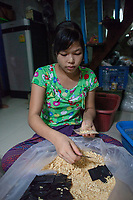 "Ma Thandar*, 15 years, packaging rice noodles. She is employed by Nila* and her husband who run a home-based business baking cakes and packaging dry noodles which are sold in local markets. ""We, the young girls working here, dropped school at the age of 10 and have been working in this business since we are 12. We do lighter work than the boys, for example packaging dry noodles in little plastic bags. We support our families in the village with this income"", tells Ma Thandar*."