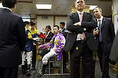 Champion jockey Matthew Chadwick at the weighing room surrounded by stewarts at the Hong Kong Jockey Club's Happy Valley racecourse.