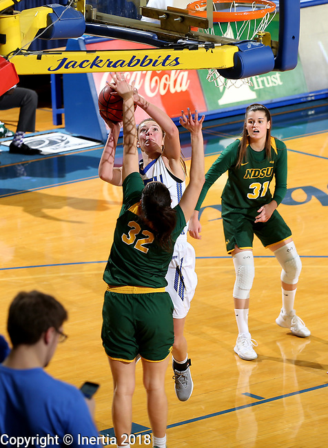 BROOKINGS, SD - JANUARY 6: Tagyn Larson #24 from South Dakota State University takes the ball to the basket against Reilly Jacobson #32 from North Dakota State University  during their game Saturday afternoon at Frost Arena in Brookings, SD. (Photo by Dave Eggen/Inertia)