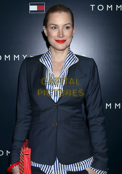 Alice Evans.Tommy Hilfiger West Coast Flagship Grand Opening Event, West Hollywood, California, USA, .13th February 2013 ..half length suit blue striped white shirt red clutch bag lipstick blazer .CAP/ADM/RE.©Russ Elliot/AdMedia/Capital Pictures.