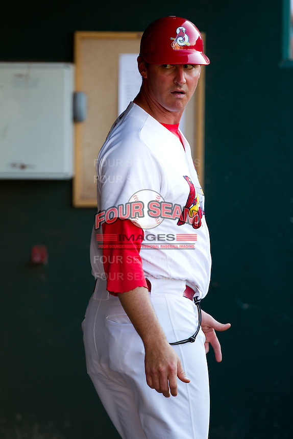 "Manager Ron Warner (57) of the Springfield Cardinals talks with the pitching coach about a called ""balk"" during a game against the Tulsa Drillers at Hammons Field on July 18, 2011 in Springfield, Missouri. (David Welker / Four Seam Images)"