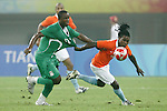 07 August 2008: Olubayo Adefemi (NGA) (13) and Royston Drenthe (NED) (right) challenge for the ball.  The men's Olympic team of the Netherlands played the men's Olympic soccer team of Nigeria at Tianjin Olympic Center Stadium in Tianjin, China in a Group B round-robin match in the Men's Olympic Football competition.