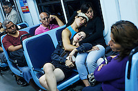 Ceci sleeps as she travels on a bus with Meme and other dancer friends on their way to her mother's house to celebrate her birthday. Ceci and Meme are tango dancing partners and work at a restaurant in the El Caminito area of Buenos Aires.