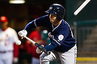 Ben Theriot (23) of the Northwest Arkansas Naturals lays down a bunt during a game against the Springfield Cardinals on May 13, 2011 at Hammons Field in Springfield, Missouri.  Photo By David Welker/Four Seam Images.