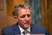 United States Senator Jeff Flake (Republican of Arizona) makes a statement to the US Senate Committee on the Judiciary prior to a vote on the nomination of Judge Brett Kavanaugh to be Associate Justice of the US Supreme Court to replace the retiring Justice Anthony Kennedy on Capitol Hill in Washington, DC on Friday, September 28, 2018.  If the committee votes in favor of Judge Kavanaugh then it goes to the full US Senate for a final vote.  Flake voted to send the nomination to the US Senate floor but asked that the final vote be delayed pending an FBI check on the incident between Dr. Ford and Judge Kavanaugh when they were in high school.<br /> Credit: Ron Sachs / CNP<br /> (RESTRICTION: NO New York or New Jersey Newspapers or newspapers within a 75 mile radius of New York City)