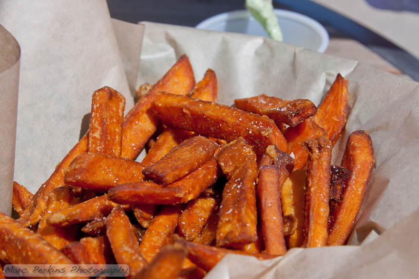 Seabirds's Sweet Potato Fries: Crispy on the outside, soft and melty on the inside, salted to perfection, and served with a creamy dipping sauce.