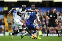 Aboubakar Kamara of Fulham tries to take the ball past Chelsea's Eden Hazard during Chelsea vs Fulham, Premier League Football at Stamford Bridge on 2nd December 2018