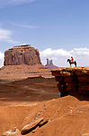 AZ, Monument Valley, Bruce, Native American Navajo Indian on horseback, stone bluff .Photo Copyright: Lee Foster, lee@fostertravel.com, www.fostertravel.com, (510) 549-2202.Image: azmonu204