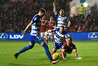 Bobby Reid of Bristol City is challenged by Joey van den Berg of Reading during the Sky Bet Championship match between Bristol City and Reading at Ashton Gate, Bristol, England on 26 December 2017. Photo by Paul Paxford.