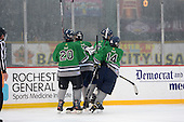 Notre Dame Fighting Irish of Batavia players Spencer Misiak (17), Cam Chamberlain (20), Brad Misiak (16), and Kris Bank (14) celebrate a goal during a varsity ice hockey game against the Brockport Blue Devils during the Section V Rivalry portion of the Frozen Frontier outdoor hockey event at Frontier Field on December 22, 2013 in Rochester, New York.  (Copyright Mike Janes Photography)