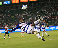FC Dallas defender Jair Benitez goes up and kicks a shot away from goal during the second half of game between Chivas USA and FC Dallas at the Home Depot Center in Carson CA on June 26 2010. FC Dallas 2, Chivas USA 1.